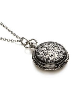 I cant even being to describe how much i want this!  Antoine Wateau Rococco-inspired watch-necklace. $24