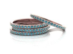 We are happy to introduce this new Teal Blue Diamonds band as a part of our up-scale series! The band is made in 14K Rose Gold set pave with Teal Blue Diamonds (irradiated diamonds). Diamonds are just