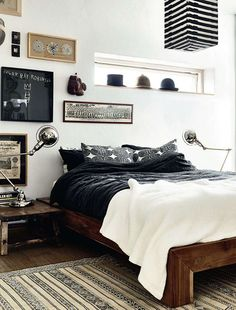 black, white, wood, rustic, distressed, feature wall, hats, striped, chandelier, rug
