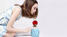 The campaign for Miu Miu's first ever fragrance has been released with actress Stacy Martin as its star. Photographed by Steven Meisel, the brunette wears a blue printed dress while peaking over at the vintage style perfume bottle with intrigue. Stacy Martin, Miu Miu, Perfume Ad, Perfume Bottles, Beauty Ad, Hair Beauty, Beauty Tips, Beauty Products, The Brunette