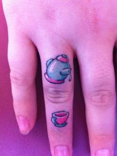 two tiny tattoos of a tea pot and a tea cup make a cute finger tattoo design  I just like it cause it's tiny!!!