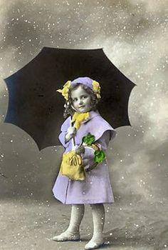 Little girl & her umbrella. Reminds me of the cute lil' Morton Salt girl.