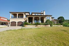 Panoramic Hill Country & Lake Travis views from multiple rooms and balconies