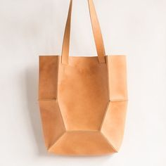 ribbed leather bag - This ribbed leather bag is inspired by the traditional Japanese art of Origami. The accessory is structured and geometric in its shape and is const...