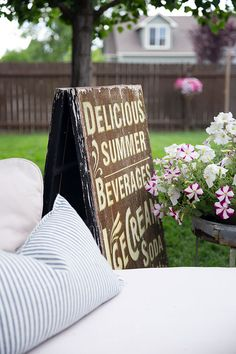 Delicious summer beverages, ice cream soda sign is a fun and whimsical addition to this vintage French farmhouse patio decor. Backyard Fences, Backyard Ideas, Kid Friendly Backyard, Roasting Marshmallows, Outdoor Fun, Outdoor Spaces, Summer Beverages, Garden Structures, Small Patio