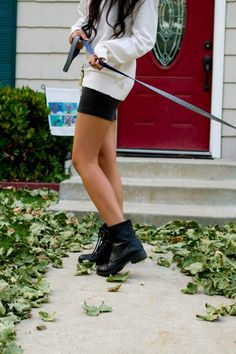 combat boots with black skirt or dress and big white sweater or sweatshirt over it.