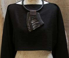 chunky jewelry: large polished buffalo horn mounted on rubber