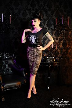 Vampira Ghoul Gang Shoulder Tee - Show off your Vampira pride in this Ghoul Gang tee.  Made of a soft cotton that comfortably hugs your curves, this top is worn in an oh-so-slightly risque off the shoulder style and looks fabulous paired with a skirt, pants, or jeans!