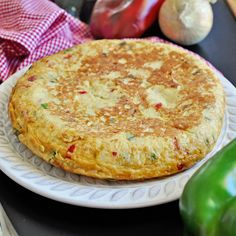 This Spanish Tortilla Paisana Omelette Recipe is easy to make and loaded with veggies. Learn how to make this classic tortilla and impress your guest with a tasty Spanish omelette. Spanish Dishes, Spanish Food, Spanish Cuisine, Spanish Recipes, Spanish Tapas, Spanish Tortilla Recipe, Spanish Omelette, Omelette Recipe, Healthy Omelette