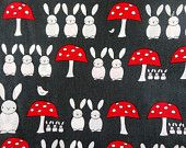 Creative Thursday Fabric - 1 Metre The Red Thread Bunnies and Toadstools in Dark Grey