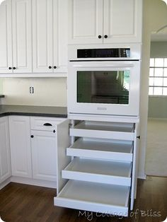 great kitchen remodel, I would love these shelves for cookware and baking pans!