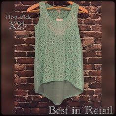 HPFloral High-Low Tank in Mint5/1 5/10 100% Polyester with rhinestone embellishment on the front. Dry Clean Only. This tank is adorable, pictures don't do it justice! Available in S,M and L. Also available in Mint, Pink and White. Could be used as a bathing suit cover-up or dressed up for a night on the town. Tops Tank Tops