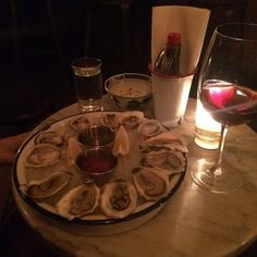 The Leadbelly - New York, NY, United States. Yummy oysters and a glass of wine to start the night right.