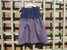 Baby girl's navy dress knitted and sewn