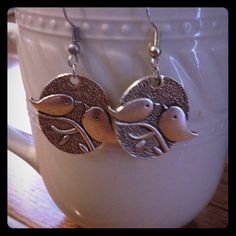 Silver bird earrings Artisan handmade silver vintage style bird on a branch earrings. New never been worn just put them in for that picture. Very cute 1 1/2 inch with hook backs. Jewelry Earrings