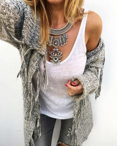 I love the looks of this sweater, the necklace is pretty cool too.