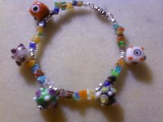 "Colorful bumpy beads and milliefiori chip bracelet. I love the colors and the way this bracelet just screams ""fun""."