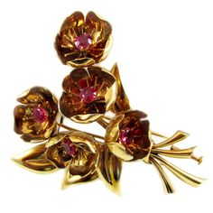 Van Cleef & Arpels Paris Retro Ruby Gold Brooch   From a unique collection of vintage brooches at https://www.1stdibs.com/jewelry/brooches/brooches/