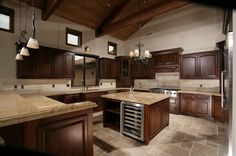 viking appliances....  granite counters.....  custom cabinets.....  the meals you can create and enjoy here...  it's a dream kitchen, not exactly the way i would want it but most of the key elements are there.   different layout for me though :)