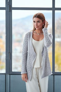 A beautiful lace pattern adorns the lower part of this jacket with overlapping fronts, while garter stitch rules on the top part. The stitch patterns are divided by a tuck and the jacket has identical hems. A deep elegant v-neck allows it to be worn loose creating waterfall fronts. Or you can close it with jewelry or a shawl pin for a more tailored look. The jacket is named Sarya; the night traveler hence knitted in the stunning Jagger Spun, Zephyr Lace, held double, because of its luster…