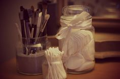 Sand in a jar to hold your make up brushes! || use old Yankee Candle jars used for cotton buds etc.