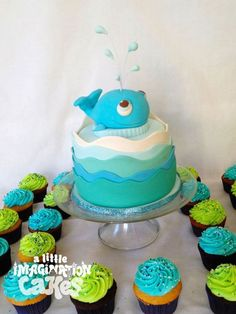 Whale cake with cupcakes. Super cute birthday idea