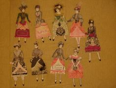 from ALTERED ARTIFACTS, some dressed dolls for Valentines or Christmas. note the use of feathers, fur, flowers, and collars