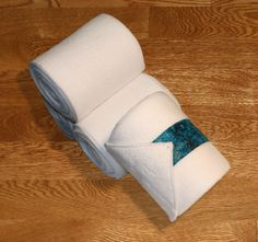 """White Polos with Teal Galaxy Velcro Straps, $22.00 by KLMequestrian Deck out your horse in style with these white polos made with quality white fleece embellished with teal galaxy fabric on the velcro strap. Made with industrial strength velcro to ensure a proper hold. Two sizes offered: Pony: 2 yards (6ft) long, 4"""" wide Horse: 3 yards (9ft front, 11ft hind) long, 5"""" wide. Four colors offered: Black, Navy, White, or Gray. Set of four."""