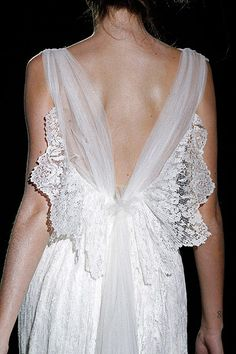 Raimundo Bundó bridal gown - it's like a butterfly on the back is a cool idea. Esp. since we're having lots of butterfly things in our wedding now.