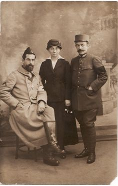 WW1. French priest (sitting) with a religious and a Red Cross ( which protects…