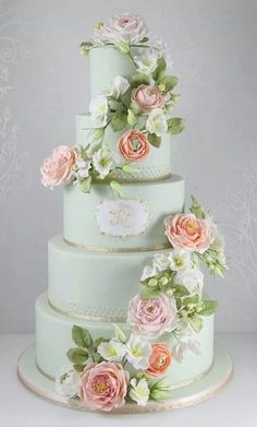 Beautiful light blue wedding cake with ribbon, floral and monogram detail.... ᘡղbᘠ