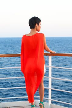 A bold orange draping shirt. Very apropos for a trip to the islands.