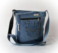 Denim crossbody bag, jean sling bag, jean messenger bag, denim crossbody purse, jean bag, unisex recycled clothing, vegan denim purse This really cute and very functional bag was made of different kind of jeans... This handmade bag has pockets inside. It is useful every day hand bag!
