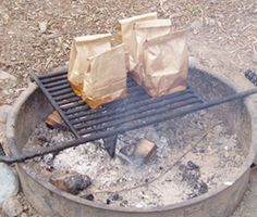 Breakfast In A Bag - line bottom of paper bag with bacon, making sure to cover all of the paper and slightly up the sides. Place 2 raw biscuits on top of bacon. Crack egg(s) and drop on top. Add salt and pepper. Fold top of bag over a couple of times. Place bag on grate over campfire. Eggs are done when the grease from the bacon is about 1/2 way up the side of the bag.