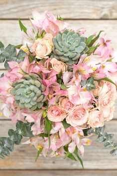 Showstopper Bouquet $55 and up - The snazziest part of this particular bouquet (besides the fact that it seriously lives up to its namesake) is that the succulents will live on even after the flowers wilt. See more blooming bouquets that are perfect for Mother's Day at HouseBeautiful.com. #MothersDay #MothersDayFlowers #FlowerBouquets #BuyFlowers #MothersDay2018 (If you click to buy this product, we earn :moneybag:!)