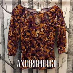 """Anthropologie blouse with cutouts*was $20* Watercolor print top in oranges, creams, black, mauve, and dark violets and purples. Features three keyhole cutouts along the neckline, a boat neck, three quarter length sleeves with a slight bubble effect.  Beautiful top in great condition, but too small for me. Labeled extra small. 90% tencel, 10% wool. Hand wash. Measures 14"""" armpit to armpit and 22"""" shoulder to hem. Anthropologie Tops Blouses"""