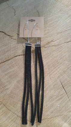 Check out this item in my Etsy shop https://www.etsy.com/listing/251357545/long-black-suede-fringe-earrings