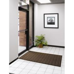 Design by AKRO Boulevard Mat. Many sizes and colors. 3' by 4', $97.75. Red / black.