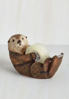 Alma Otter Tape Dispenser. Your colleagues often stop to swoon over your oh-so adorable otter-shaped tape dispenser by Streamline! #brown #modcloth