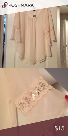 Silk and Lace Top It's a cream colored sheer top with lace embroidery on the sleeves. The sleeves hit about elbow length. NWT Rue21 Tops Blouses