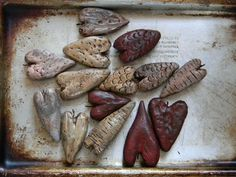 few hearts that I'll be making into jewelry sculpted from paperclay, painted & aged..