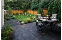 Great small backyard. Love the patio + landscape.