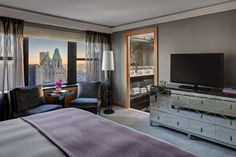 The master bedroom is located on the suite's second floor. Guests can wake up to great views of the New York skyline.