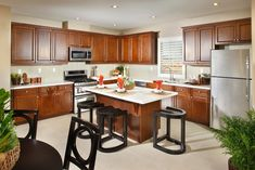 Breakfast bar kitchen island surrounded by cherrywood cabinetry