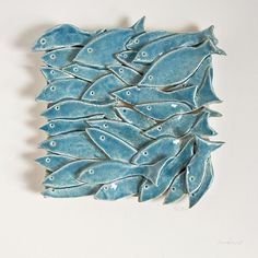 group project- cut fish shapes out of clay and paint, then attach together to create group sculpture