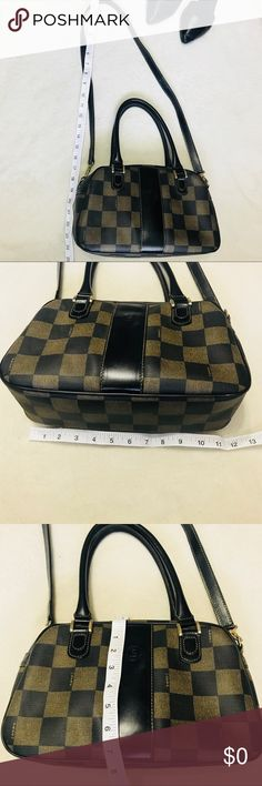 """ADDITIONAL PICTURES FOR VINTAGE FENDI FEATURES  Super cute!!  80's Bag  • Vintage Fendi Satchel Handbag  • Checkered  • Black and Brown • Gold tone Hardware  • Top Zipper Closure with a signature Fendi Zipper Pull  • Interior Zippered Pocket  • Full length: Approx 24"""" • 11.5"""" x 8"""" x 4""""  • Serial Number: 579-810430-059 • Made in Italy.  • Good Condition. Bag has some signs of wear, please check out pictures  • Additional pictures at another listing.     Please feel free to ask any question or…"""