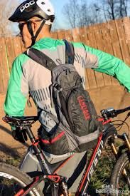 Image result for rear view of mountain bike rider wearing a hydration pack