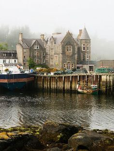 dock and hotel in misty Lochinver , North of Scotland
