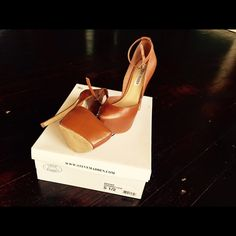 Steve Madden brand Please read all info before contacting. Do not waste mine or your time. Slightly used. Purchased from south coast plaza. Size 5.5 cognac color. Adjustable ankle straps, comes with box. Similar to YSL tribute heels.Price is firm. Steve Madden Shoes Heels