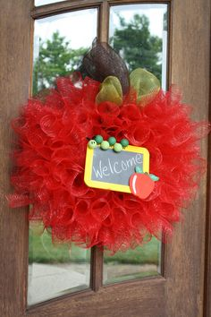 Back to school teacher wreath - this is so cute it might actually be worth 65 bucks for my classroom door.